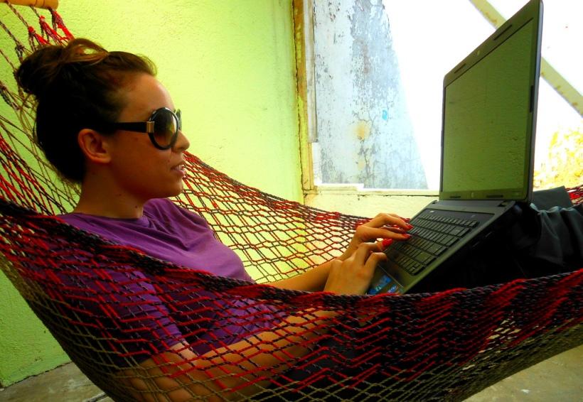 Working from home, in Costa Rica circa 2011, in the backyard hammock.
